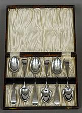 A set of six silver dessert spoons, hallmarked London 1843, maker's mark of George Adams Old English pattern, crested, cased.