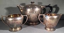 An Art Deco Indian silver three piece tea set, hallmarked for Delhi, maker's mark of Warner Bros. Comprising: teapot, milk jug and sugar bowl.  The teapot 14 cm high.  (3)