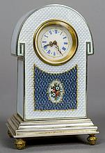 An enamel decorated silver desk clock Of domed form, with blue guilloche enamel decoration centred with a floral panel.  8.5 cm high.