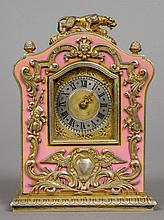 A pink enamel decorated unmarked silver gilt desk clock The domed top surmounted with a tiger.  9.5 cm high.