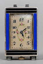 A miniature enamel decorated silver carriage clock With blue and black enamel decorations.  4.25 cm high.