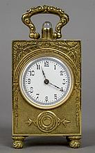 A miniature 935 silver gilt repeating carriage clock The case with cast foliate decoration, the white enamel dial with Arabic numerals.  9 cm high.