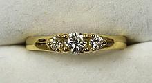 A fine quality 18 ct gold three stone diamond ring