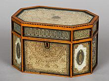 An early 19th century rolled paper tea caddy Of chamfered rectangular design with glass fronted panels, some sections set with pearl and ruby glass chippings.  19.5 cm wide.