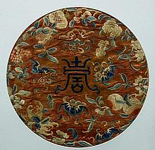 A Chinese embroidered silk roundel Centred with Shau character, framed and glazed.  54 x 65 cm overall.