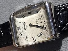 A vintage Longines gentleman's wristwatch Of domed rectangular form.  2.75 cm wide.