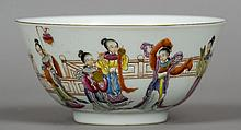A Chinese porcelain bowl Decorated in the round with female figures in various pursuits, blue painted six character Qianlong seal mark to base.  16 cm diameter.