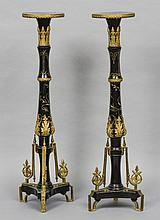 A pair of 19th century ormolu mounted ebonised torcheres Each circular top above an ormolu mounted and incised decorated column, standing on a tripartite base.  Each 110 cm high.  (2)