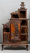 A 19th century Chinese side cabinet Of stepped architectural form, with various cupboards and shelved sections, with carved and pierced decorations.  220 cm high.