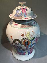 A Chinese porcelain baluster vase and cover Decorated with various figures, red painted six character Qianlong seal mark to base.  41 cm high.