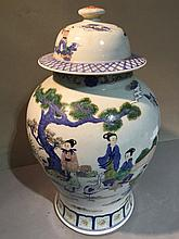 A Chinese porcelain baluster vase and cover Decorated with female figures in a continuous garden landscape, blue painted six character Qianlong seal mark to base.  43 cm high.