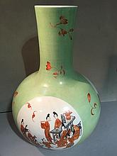 A Chinese porcelain vase Of bulbous form, decorated with figural vignettes interspersed with floral sprays, red painted six character Guangxu mark to base.  58 cm high.