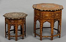 A North African ebony, ivory and bone inlaid octagonal folding table Of typical form, with profusely inlaid decoration; together with a smaller similar example.  The largest 60 cm wide. (2)