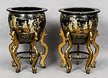 A pair of large late 19th century chinoiserie lacquered jardinieres on stands Each decorated in the round with vignettes of various figures amongst floral scrollwork, standing on a detachable plinth base with scrolling legs. Each 58 cm diameter. (2)