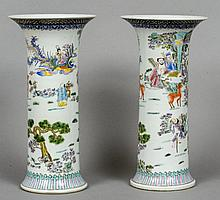 A pair of Chinese porcelain vases Each decorated with figures and deer in a continuous landscape, blue painted six character Kangxi mark to base.  42 cm high.  (2)