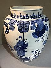 A 17th century Chinese transitional period blue and white porcelain vase Decorated with figures in a continuous garden landscape.  46 cm high.