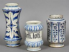 Three 18th/19th century Italian apothecary jars Each with blue and white decoration, one inscribed.  The largest 28 cm high.