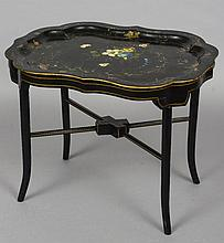 A Victorian lacquered papier mache tray  Mounted on a later fitted stand, the shaped stand with painted with birds and foliage.   78.5 cm wide.