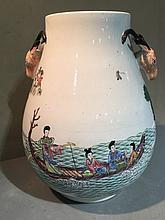 A Chinese porcelain twin handled baluster vase The handles formed as deer masks, the body decorated with figures in a continuous river landscape, blue painted four character Qianlong seal mark to base.  33 cm high.