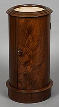 A mahogany cylindrical pot cupboard Of typical form, with marble inset top.
