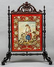 A Victorian tapestry inset carved fire screen Centrally decorated with a couple with a dog.  110 cm high.