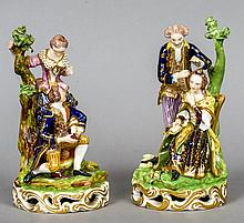 A pair of early 19th century Bloor Derby porcelain figural groups, The Hairdresser and another Both typically modelled and decorated, red painted marks to base.  18.5 cm high.