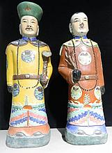 A pair of Chinese Republic Period porcelain figures Modelled as a courtly figure holding a ruyi sceptre and his companion, impressed marks to base.  55 cm high.  (2)