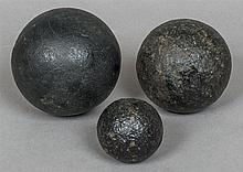 Three late 17th/early 18th century iron cannon bal