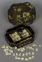 A 19th century chinoiserie decorated papier mache