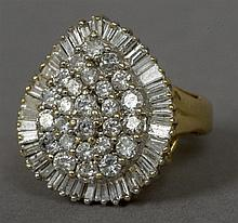 An unmarked gold and diamond cluster ring Of round