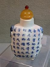 A Chinese porcelain snuff bottle Decorated in blue