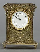 A small Continental silver gilt desk timepiece The
