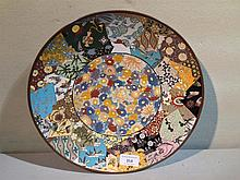 An Oriental cloisonne charger Decorated with vario