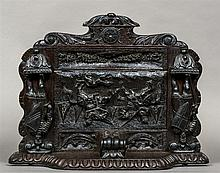 A 19th century carved oak bracket Carved with a pa