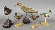 A collection of five various carved wooden wading