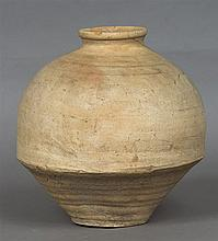 An Antique pottery vessel Standing on a conical fo