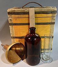 An early 20th century portable rain measuring kit