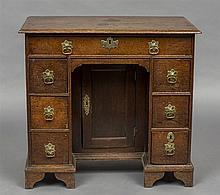 An early 18th century oak kneehole desk The moulde