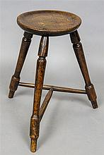 A 19th century Welsh oak cricket stool The dished