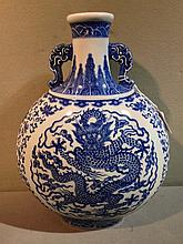A Chinese blue and white porcelain twin handled mo