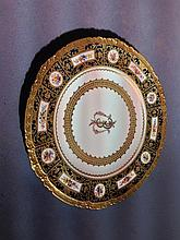 A Royal Crown Derby cabinet plate Centred with a f