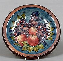 A modern Moorcroft charger Decorated in the Finche