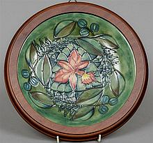 A modern Moorcroft charger Decorated in the Orchid