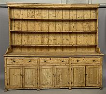 A large Victorian pine dresser The base fitted wit