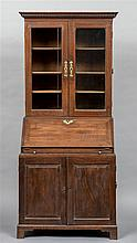 A George III mahogany campaign bureau bookcase The