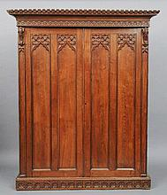 A Victorian carved oak Gothic Revival wardrobe, i