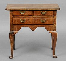 An 18th century and later walnut lowboy The line