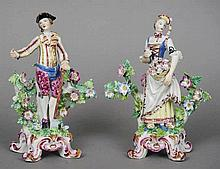 A pair of 19th century English porcelain figures,
