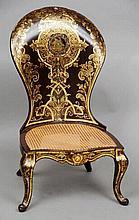 A Victorian papier mache spoon back nursing chair