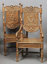 A pair of 19th century carved oak open armchairs